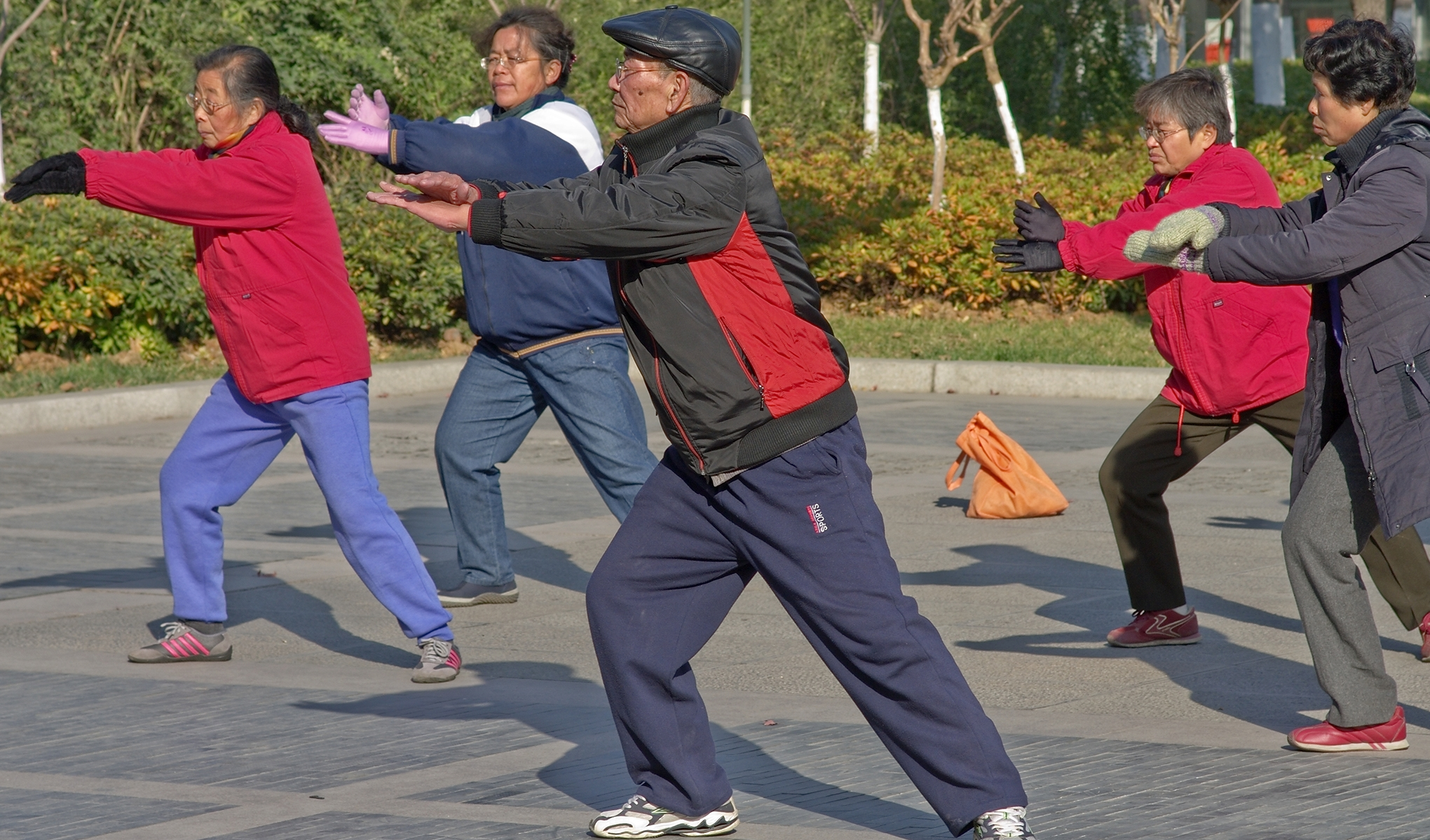 Chinese adults exercising outdoors