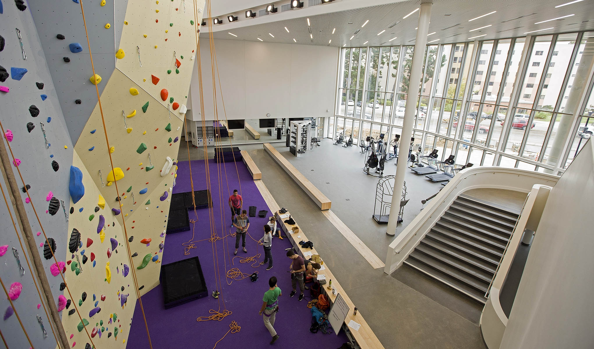 Aerial photo of a gym featuring a climbing wall and exercise equipment